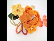 ふっくらちりめん花飾りコ-ム2点セット オレンジ